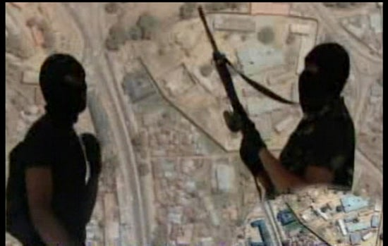 A screen grab made on October 21, 2010 in Kano from a video allegedly released by the Nigerian Islamist sect Boko Haram in northern Nigeria reportedly shows two alleged sect members standing against a background of a Google Earth shot of the northern Nigerian city of Bauchi with the triangular city prison visible. Boko Haram 'spokesman' claims responsibility for the attack on the UN building in Abuja that killed 18 on August 26, 2011.