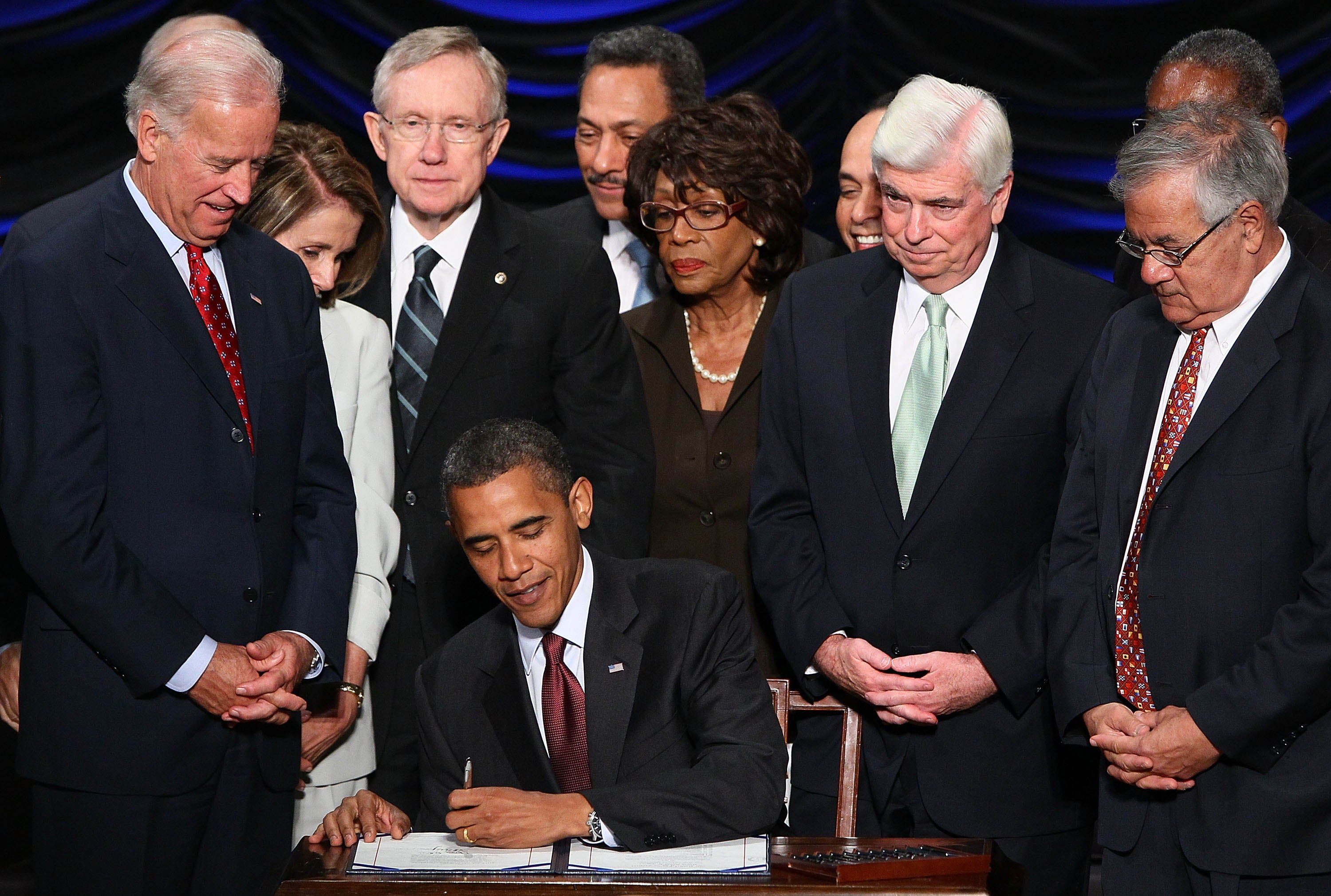 Obama signs Dodd-Frank in 2010. (Photo: OwenDB/Black Star)