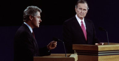 President George H.W. Bush and his challenger, Arkansas Gov. Bill Clinton, square off in the first presidential debate of 1992. Democrats stopped the judicial nomination process to leave seats open in hopes of a Clinton victory. (Photo: Dennis Brack/Newscom]