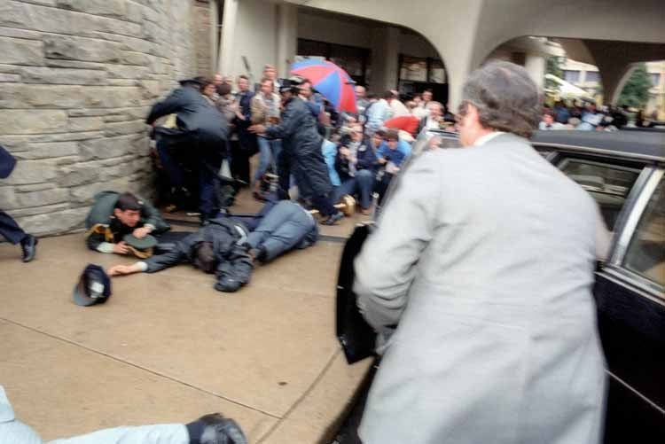 Chaos outside the Washington Hilton Hotel after the assassination attempt on President Reagan. James Brady and police officer Thomas Delahanty lie wounded on the ground. (Photo: Ronald Reagan Library)