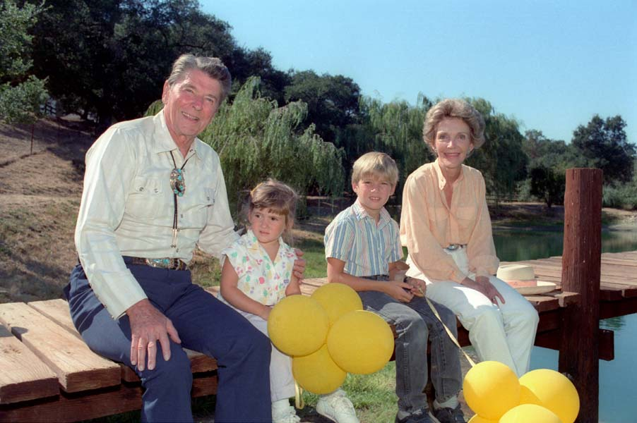 President Reagan and Nancy Reagan sitting on the dock with their grandchildren Cameron Reagan and Ashley Marie Reagan. (Photo: Ronald Reagan Library)