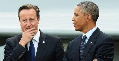 'Shoulder to shoulder': British Prime Minister David Cameron and President Obama. (Photo: Newscom)