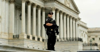 A member of the U.S. Capitol Police stands on the steps outside the House of Representatives, on Capitol Hill in Washington. (Photo: Michael Reynolds/EPA/Newscom)