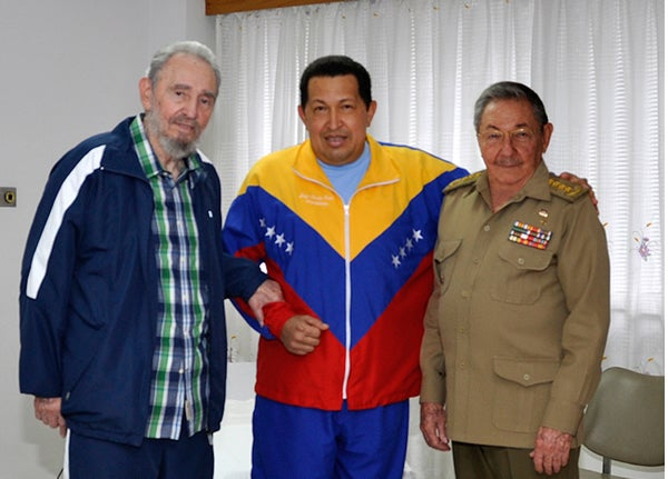 Venezuelan President Hugo Chavez Frias (C) posing with Cuban former President Fidel Castro (L) and his brother and current President of Cuba, Raul Castro, on June 17, 2011. AFP PHOTO/www.cubadebate.cu