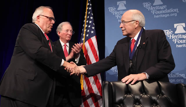 Heritage Foundation President Ed Feulner (left) and Chairman of the Heritage Board of Trustees Tom Saunders (center) present former Vice President Dick Cheney with the Clare Booth Luce Award.