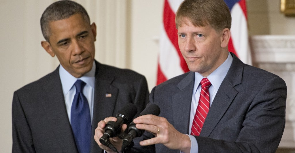 Richard Cordray, director of the Consumer Financial Protection Bureau, and President Obama at a news conference. (Photo: Ron Sachs/Newscom)
