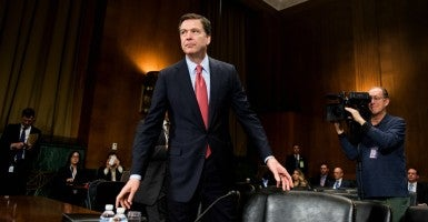 'Friends and relatives will ask you what's going on and whether they should be afraid,' FBI Director James Comey wrote to all employees. 'They should not be afraid.'  (Photo: Bill Clark/CQ Roll Call/Newscom)