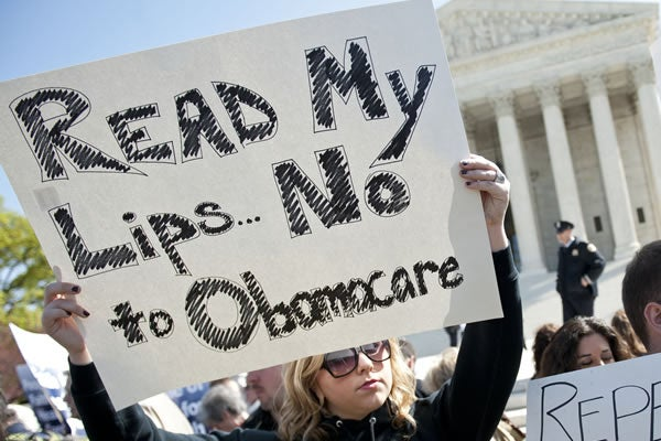 Protesters oppose Obamacare at Supreme Court
