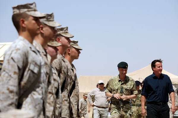 Britain's Prime Minister David Cameron greets British and U.S. troops in Afghanistan on July 4, 2011.