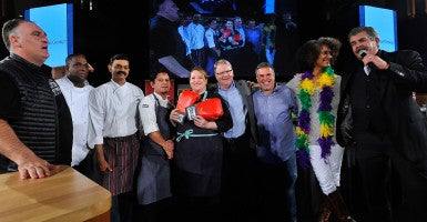 D.C. Central Kitchen CEO Mike Curtin (center) with celebrity and local chefs including José Andres (far left) and Carla Hall (second from right) at the Capital Food Fight. (Photo: Getty Images for DC Central Kitchen)