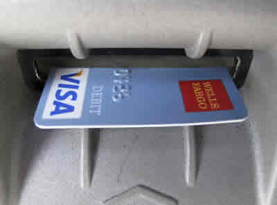 Wells Fargo debit card inserted into ATM machine