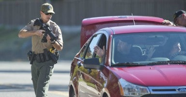 California state park officers search a car in Auburn, Calif., near the scene of a shooting rampage. (Photo: Hector Amezcua/Sacramento Bee/Zuma Wire)