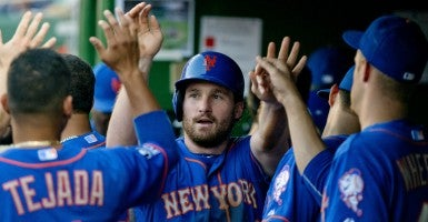 Daniel Murphy with his Mets teammates in the dugout. (Ron Sachs/ZUMA Press/Newscom)