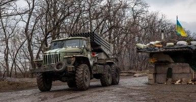 A Ukrainian BM-21 Grad rocket launcher passes a block post. (Photo: James Sprankle/Newscom)