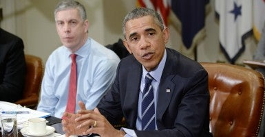 President Obama and Education Secretary Arne Duncan. The Department of Education is trying to teach parents how to do their job. (Photo: Olivier Douliery/dpa/picture-alliance/Newscom)