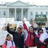 Hundreds of Latino families marching outside the White House asking Presid