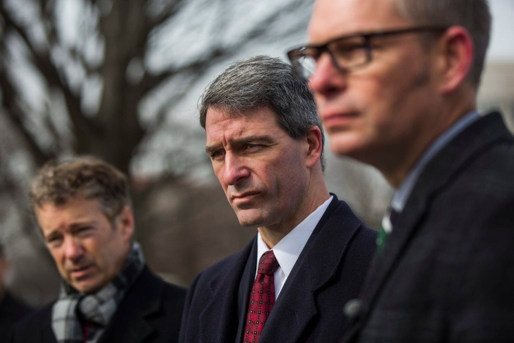 Former Virginia Attorney General Ken Cuccinelli (center), pictured with Sen. Rand Paul, R-Ky., is a leading conservative supporter of criminal justice reform. (Photo: Jim Lo Scalzo/EPA/Newscom)