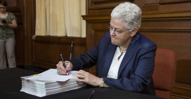 Environmental Protection Agency (EPA) administrator Gina McCarthy signs US President Barack Obama's new carbon pollution emission guideline plan at EPA headquarters. The plan, which bypasses Congress, calls for a 30 percent cut in carbon emissions by 2030. (Photo: Newscom)