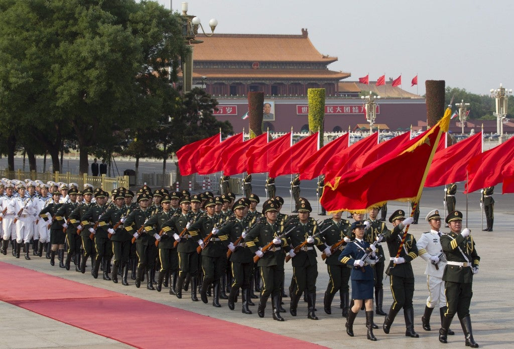 Authorities have deployed uniformed and plain-clothes police, paramilitary officers, security guards, and volunteers to monitor and control Beijing's 20 million people. (Photo: Newscom)