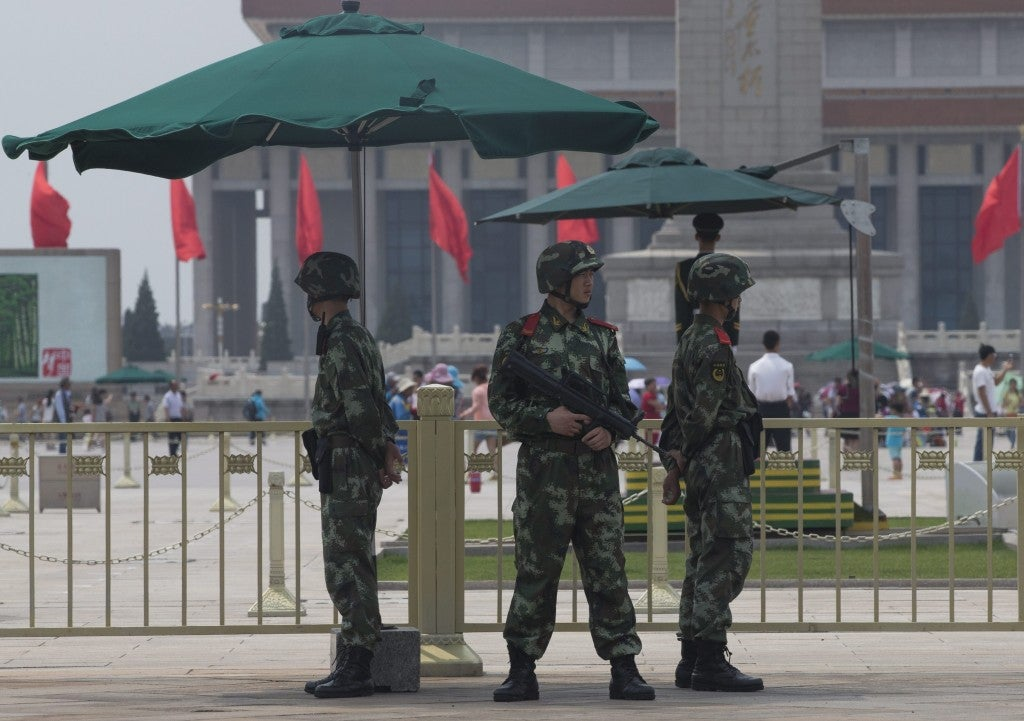 Chinese paramilitary policemen currently deployed at Tiananmen Square. (Photo: Newscom)
