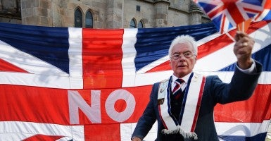 A Unionist waves the Union flag during a march in a show of solidarity for the Union of Britain in Edinburgh, Scotland. Polls are showing that the Yes and No camps are neck and neck in the Scottish Independence referendum. Scots will vote wether Scotland should become an independent country Sept. 18. (Photo: Newscom)