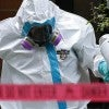 A hazmat crew cleans outside the apartment where a health care worker at Texas Health Presbyterian Hospital lives and tested positive for Ebola, in Dallas Oct. 11. (Photo: Newscom)