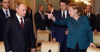 German Chancellor Angela Merkel and Russian President Vladimir Putin (Photo: Daniel Dal Zennaro/Newscom)