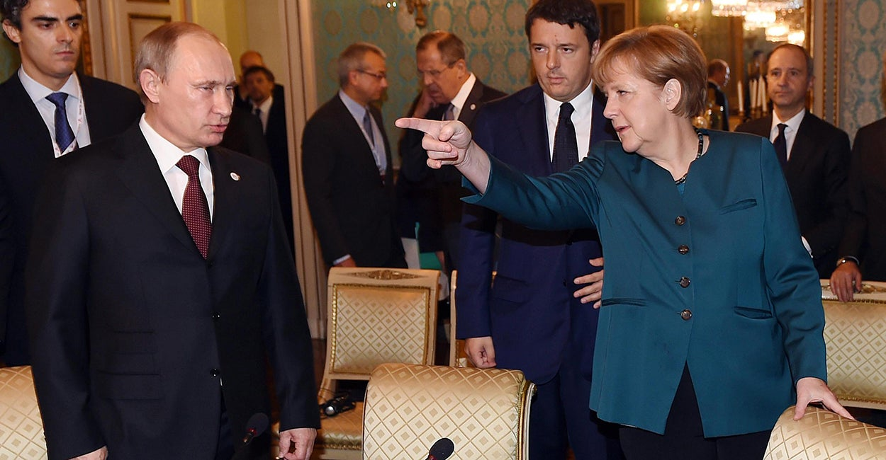 Image result for putin and merkel in disagreement