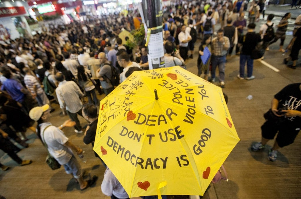 Pro-democracy protesters gather to discuss politics in the street in Mong Kok, Kowloon, Hong Kong. (Photo: Newscom)