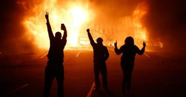 Shortly after the grand jury's decision was released, the streets of Ferguson, Mo., turn violent. (All photos courtesy of Newscom)