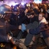 California Highway Patrol officers clash with protesters blocking traffic during a protest against the