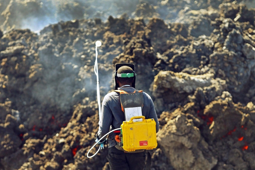 Geologist Helio Semedo of Cape Verde National Service for Civil Protection uses special gear to measure volcanic gases near the volcano. According to Volcanologic Observatory information, the volcano became more active with 'intense explosions' with greater lava flow and a bigger crater diameter. (Photo: Joao Relvas/Newscom)