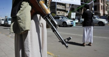 Members of the Houthi militia man a checkpoint amid fears of attacks by al-Qaeda groups. (Photo: Yahya Arhab/Newscom)