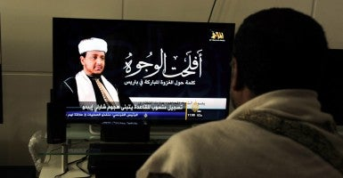 A Yemeni man watches news showing a picture of a senior member of al Qaeda in the Arabian Peninsula (AQAP). (Photo: Yahya Arhab/Newscom)