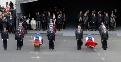 The coffins of the two of the three police officers killed in the attacks in the courtyard of the Paris Police headquarters during a ceremony to pay tribute Jan. 13. (Photo: Francois Mori/Newscom)