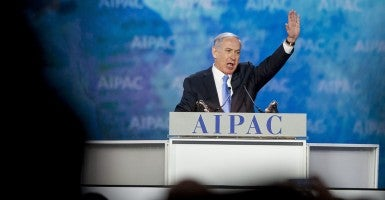 Israeli Prime Minister Benjamin Netanyahu acknowledges the audience after he addressed the annual American Israel Public Affairs Conference. (Photo: Pete Marovich/Newscom)