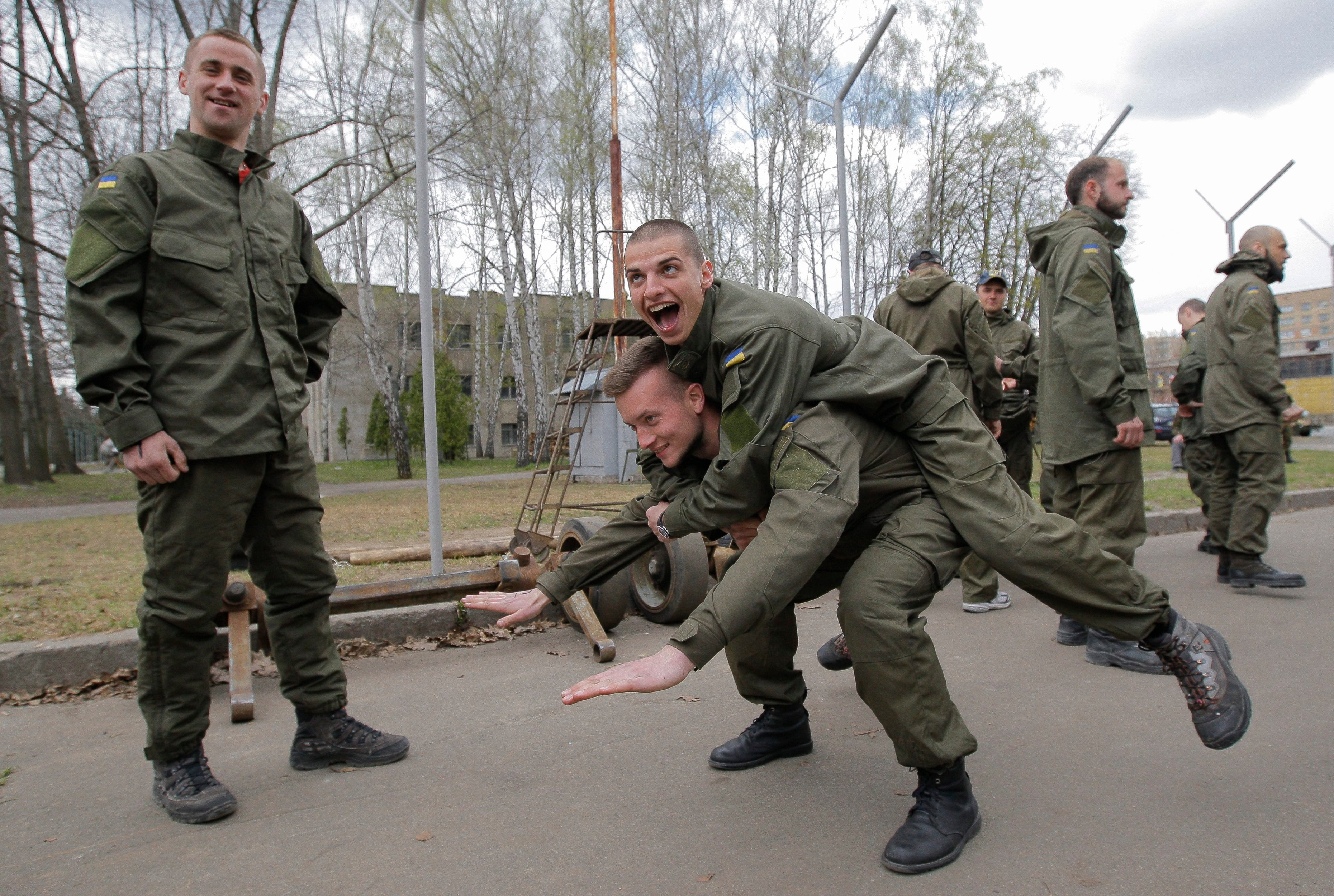 After finishing their training course, new recruits to the Ukrainian National Guard Azov Regiment goof around. (Photo: Dmitry Lipavskiy/EPA/Newscom)