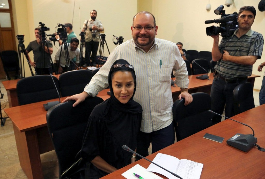 Washington Post Iranian-American journalist Jason Rezaian  and his Iranian wife Yeganeh Salehi during a foreign ministry spokeswoman weekly press conference in Tehran, Iran. (Photo: Stringer/EPA/Newscom)