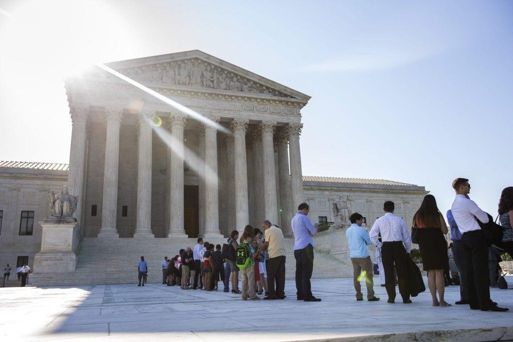 Visitors wait to enter the Supreme Court. (Photo: Jim Lo Scalzo/EPA/Newscom)