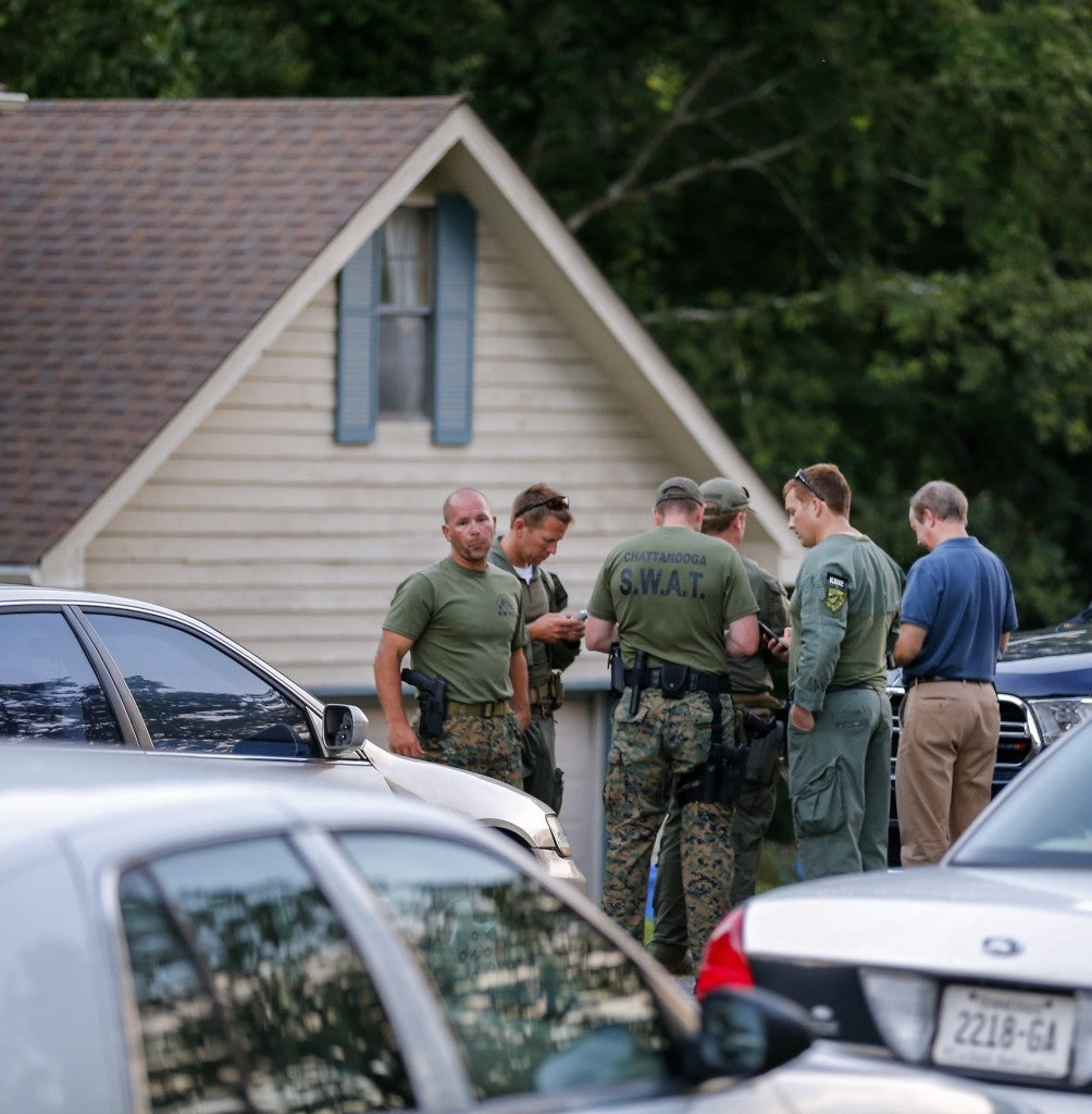 Law enforcement personnel gather outside the home of gunman Mohammod Youssuf Abdulazeez to search for a potential motive. (Photo: Erik S. Lesser/EPA/Newscom)