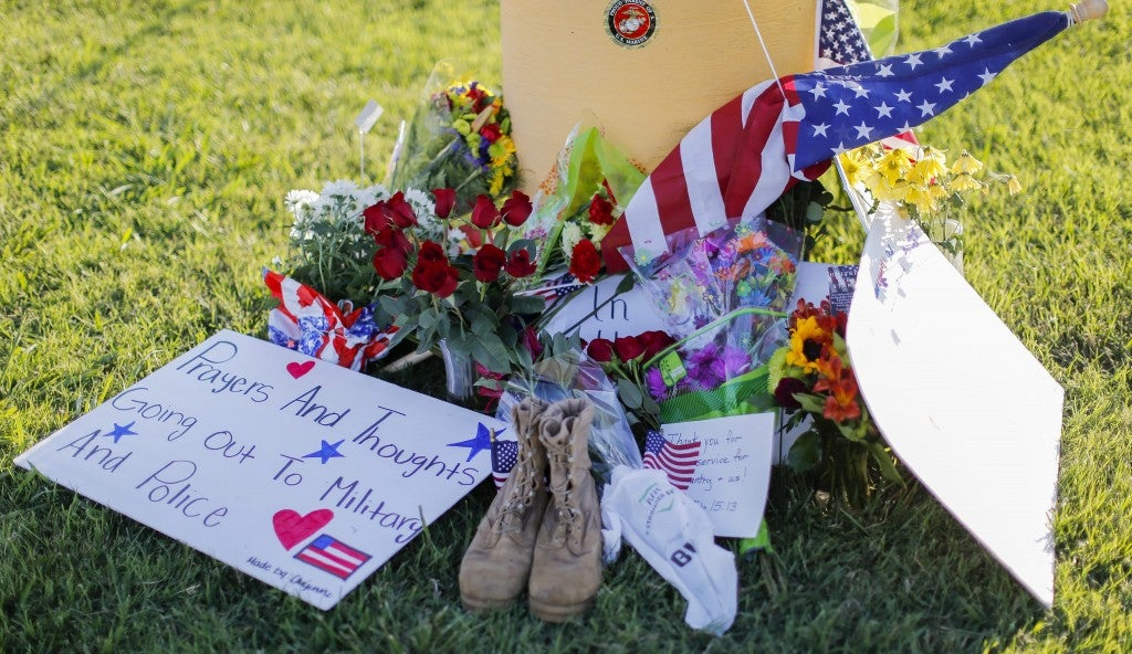 epa04849749 A memorial near a US Military Recruiting center after a shooting in Chattanooga, Tennessee, USA, 16 July 2015. Authorities say the shootings at two different locations left four US Marines and the gunman Mohammod Youssuf Abdulazeez dead.  EPA/ERIK S. LESSER (Newscom TagID: epalive751946.jpg) [Photo via Newscom]