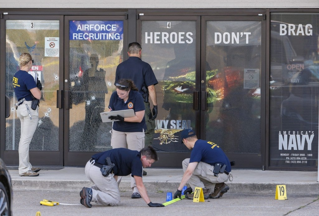 epa04849745 Members of a Federal Bureau of Investigations (FBI) Evidence Response Team work outside a US Military Recruiting storefront after a shooting in Chattanooga, Tennessee, USA, 16 July 2015. Authorities say the shootings at two different locations left four US Marines and the gunman Mohammod Youssuf Abdulazeez dead.  EPA/ERIK S. LESSER (Newscom TagID: epalive751951.jpg) [Photo via Newscom]