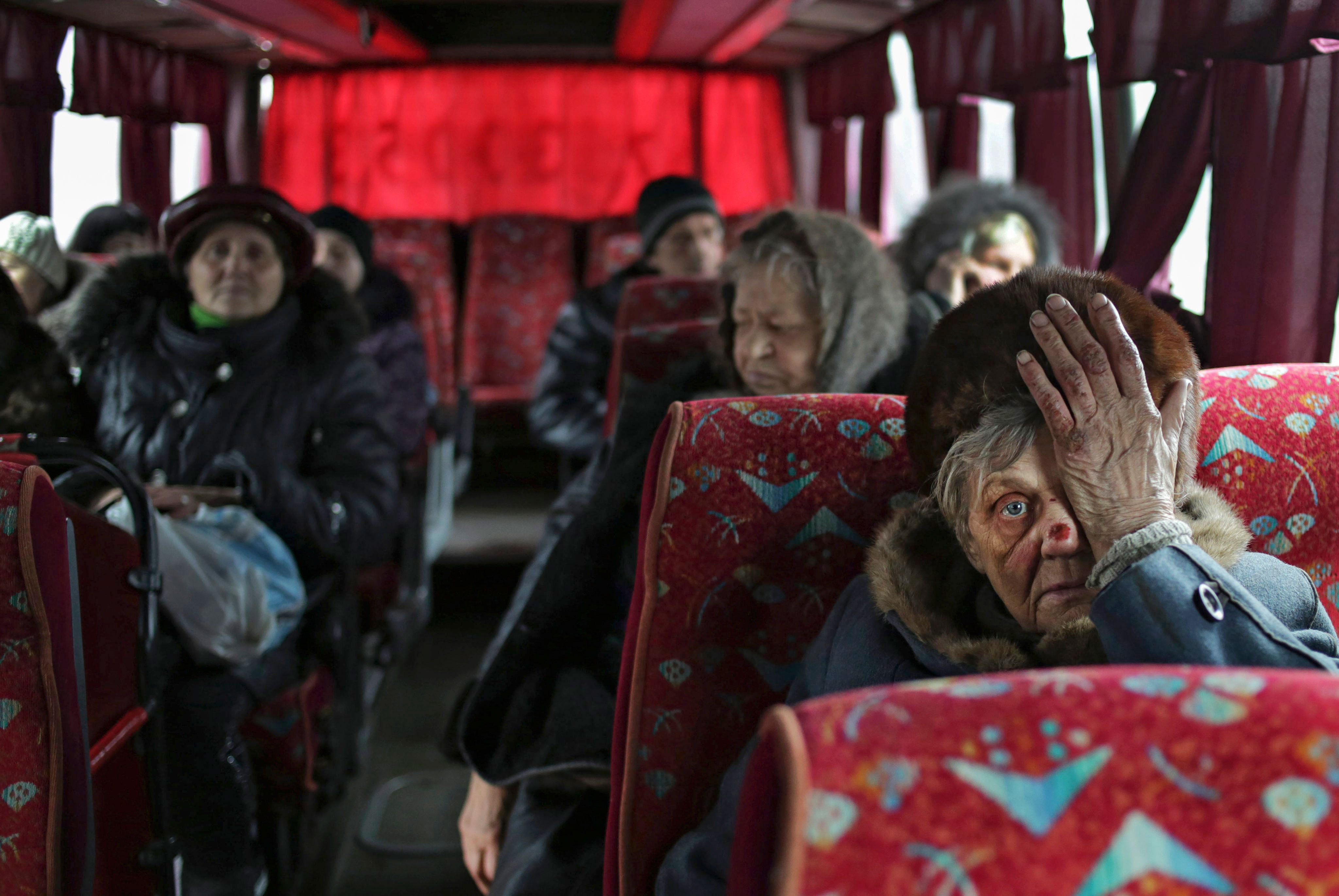 Local citizens sit in a bus as they wait to be evacuated from Debaltseve, Ukraine, Feb. 3, 2015. (Photo: Anastasia Vlasova/EPA/Newscom)