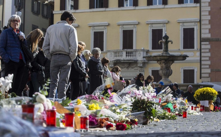 Flowers and candles placed in front of the French Embassy in Rome, Italy. (Photo: EPA/Massimo Percossi/Newscom)