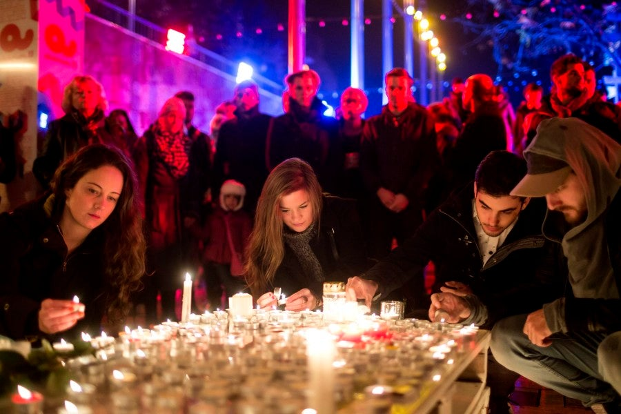 People gather with candles in Budapest, Hungary. (Photo: EPA/Balazs Mohai/Newscom)