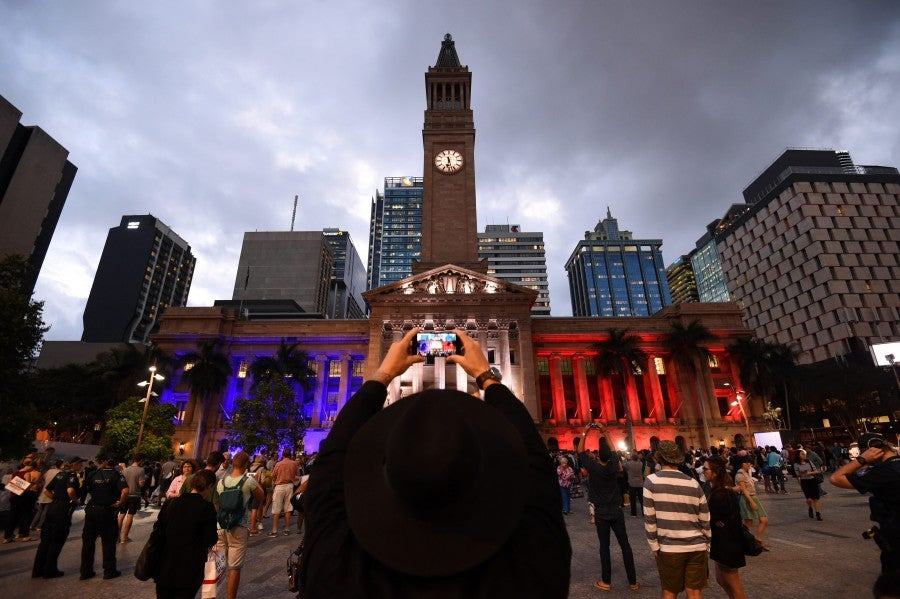 Brisbane's Town Hall is lit as the French flag during a vigil in show of support to the people of France, in Brisbane, Australia. (Photo: Newscom)