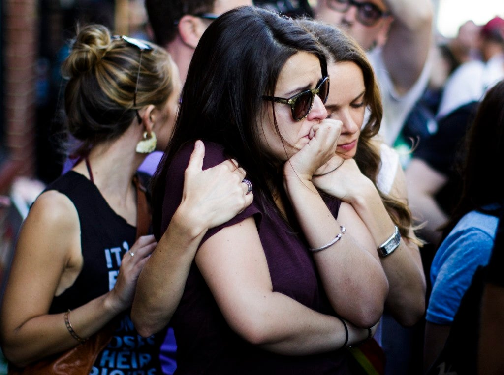 People gather for a vigil for the victims of a mass shooting at an Orlando, Florida gay club outside of the Stonewall Inn, a famous gay bar, in New York City. (Photo: Justin Lane/EPA/Newscom)