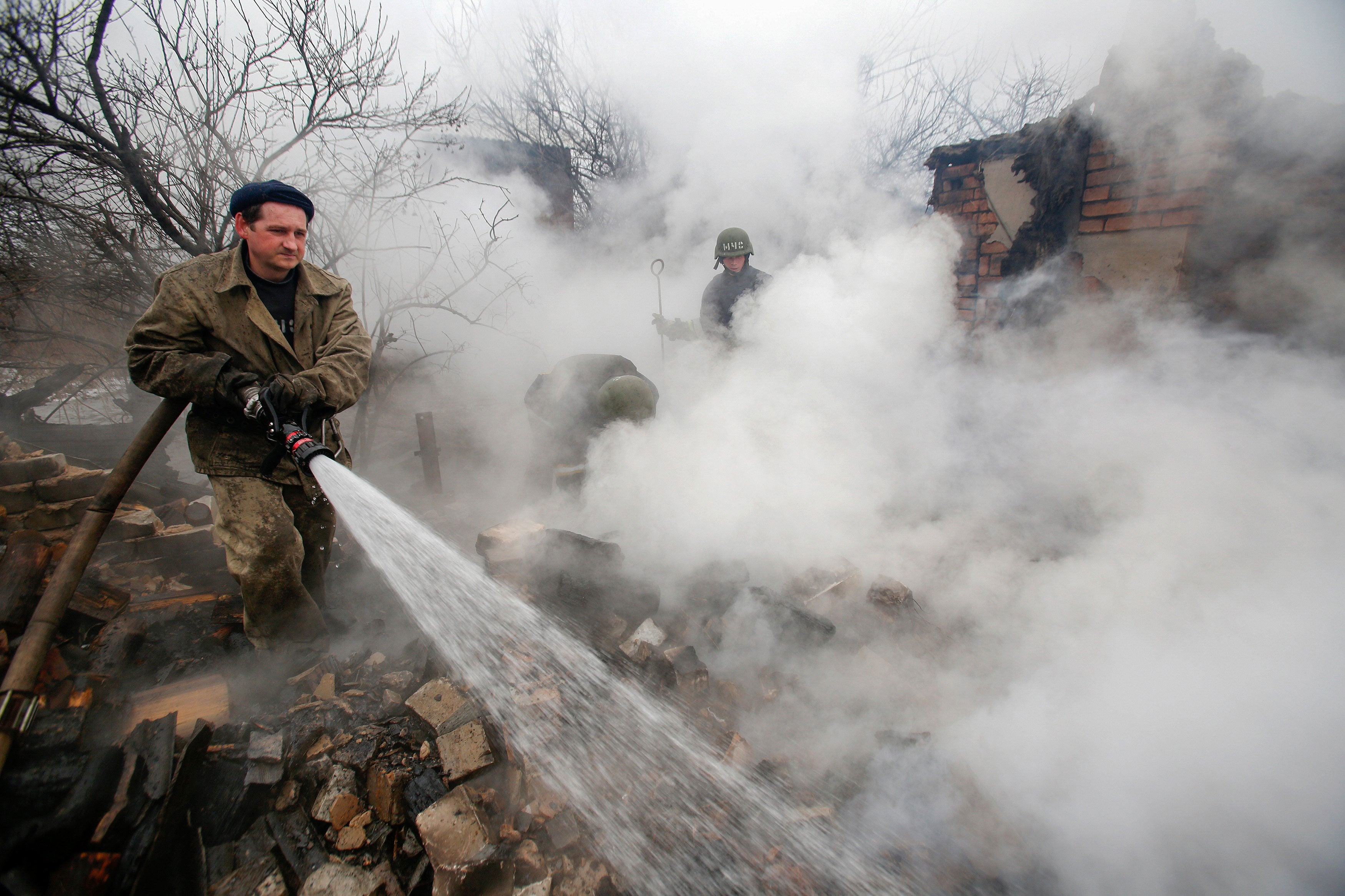 Ukrainian rescuers try to extinguish a fire after a shelling of Avdiivka, Ukraine, Feb. 25, 2017. (Photo: Valeri Kvit/EPA/Newscom)