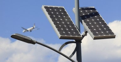 Street lights powered by both solar panels and wind generators. (Photo: Newscom)