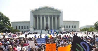 Outside the Supreme Court of the United States in June 2013 during the court's ruling on the Defense of Marriage Act. (Photo: Newscom)